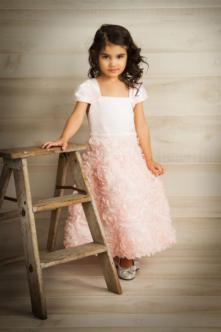 Gorgeous rosette cap sleeved dress is simply darling. The details on this dress are not cheap, it is the same quality you would find on any couture wedding gown. This darling dress would be suitable to wear for First Communions, Flower Girl, Baptism or Christening or any special occasion. Located in Oakville, Ontario, Canada or shop online www.gld-forkids.com