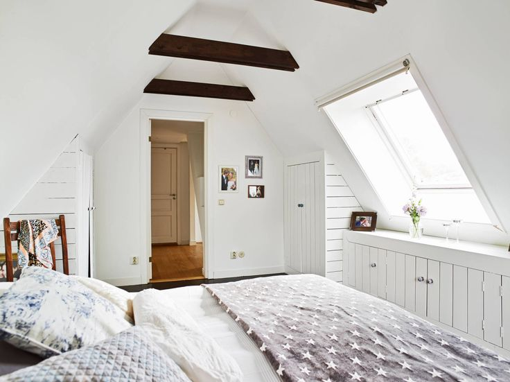 Love the beams in the pitched ceiling and skylight - would look great in the attic/playroom