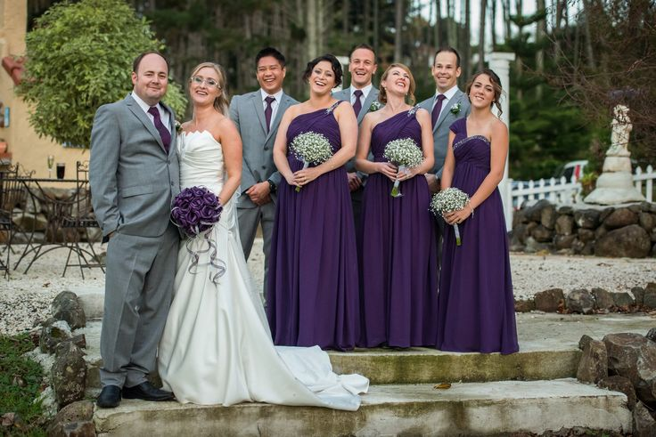 Our beautiful bride Abby with our large brides posy with trailing loops in purple and silver.                              www.flaxation.co.nz