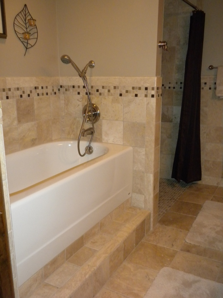 Standard bathtub raised off the floor one foot to help elevate back pain when bending over to bathe child in tub. We use a garden kneeling pad to protect our knees when kneeling on the tile ledge. We added a removable shower head to allow washing hair while in a bath chair with ease.