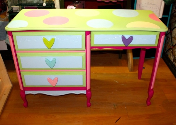 Customize Your Stuff: Remember your old Victorian white desk that had the gold trim on it? You loved it when you were a kid and sick of it by the time you moved out?   Imagine it painted funky for your 10 year old, or cute for your 3 year old. A desk is a desk -always functional just sometimes not so appealing.  Let us help you transform a memorable piece from your childhood into something for your child's memory.