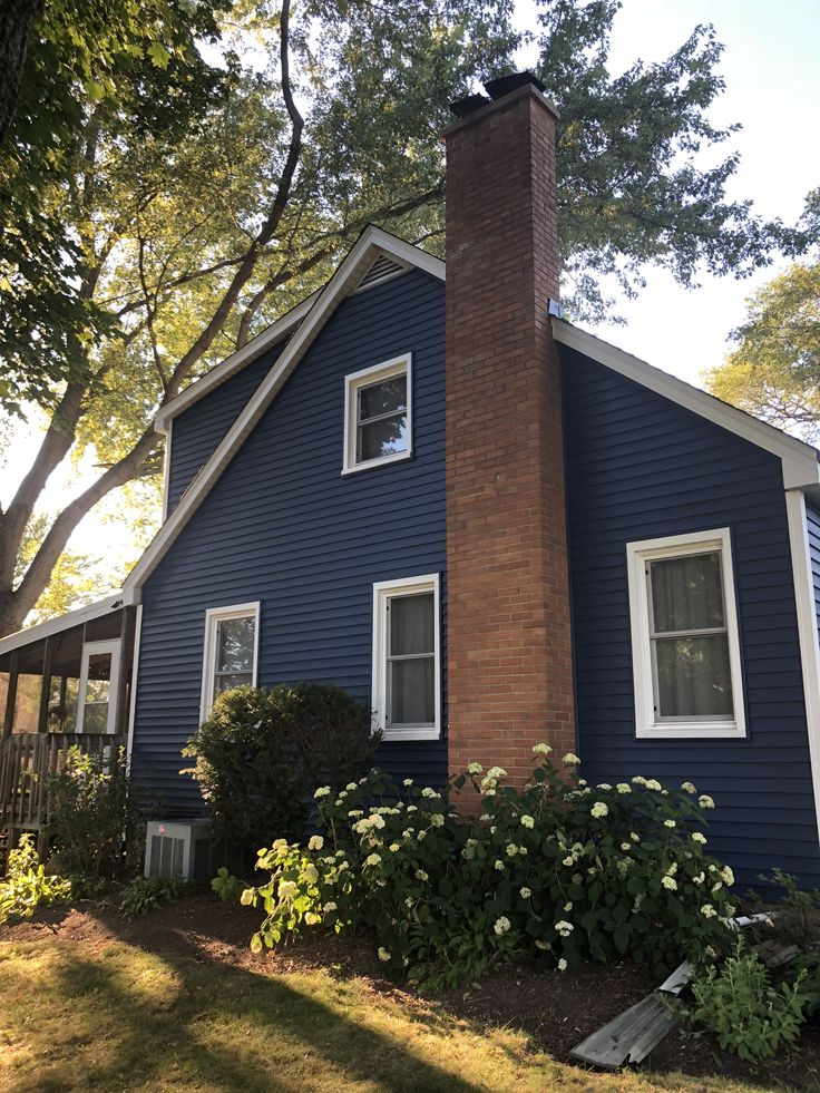 Exterior Home Siding Design: Navy Blue Siding With White Trim. CertainTeed Midnight
