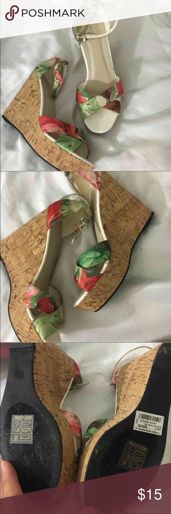 FLORAL WET SEAL WEDGES Summery floral wedges • Approx. 4.5 heel • 1 inch platform • Corkboard type material for wedge • Some fabricated and etched traction on the bottom of the wedges for stability • Ankle reinforcement Wet Seal Shoes Wedges