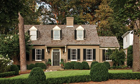 Brick cape cod brown brick cedar roof black shutters for Black brick on house