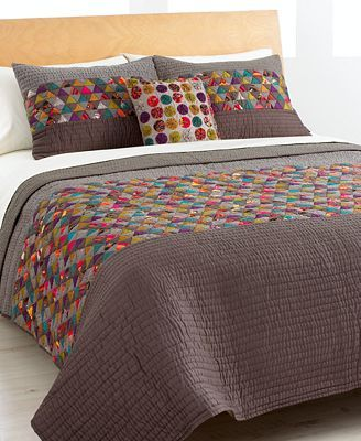 Mini Triangles Twn Quilt for sale by Macy's.  Great idea for large patches of plain color and small triangles in-between.