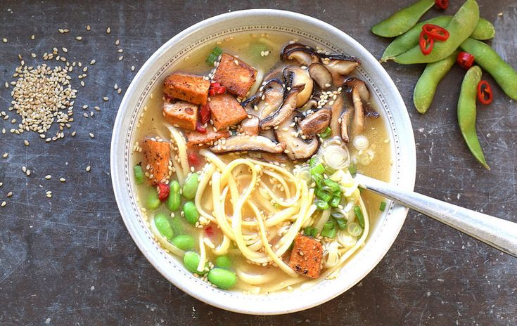 vegan miso soup with pasta, shiitake, spicy tofu and green soy beans