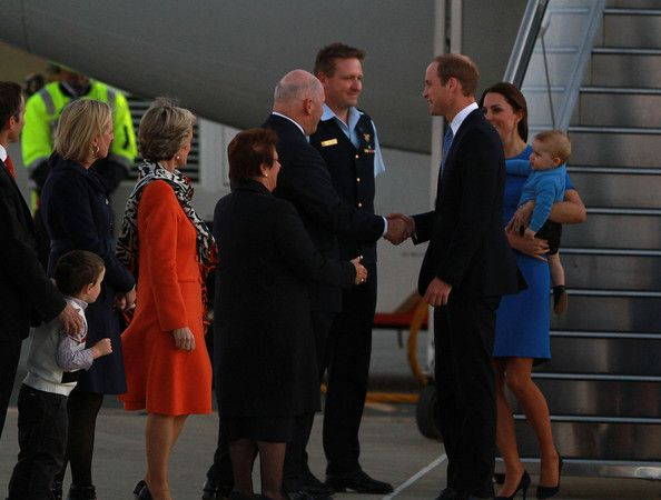 Prince William, Duke of Cambridge shakes hand with the Governor General of Australia, Sir Peter Cosgrove as the Royal Family arrive at Fairbairn Airport on April 20, 2014 in Canberra,
