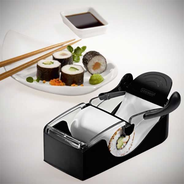 Sushi rolling machine, wish I had this. I have a bamboo mat. I'm not very good at rolling the sushi though