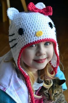 Free Hello Kitty hat pattern!    I would change up a few things:  - make the ears more triangular  - single crochet the whiskers (either directly into the hat or sewn on after) instead of using a single strand of yarn  - For the nose, maybe chain a few inches and stitch it around a couple of the hdc posts twice for a less circular nose.