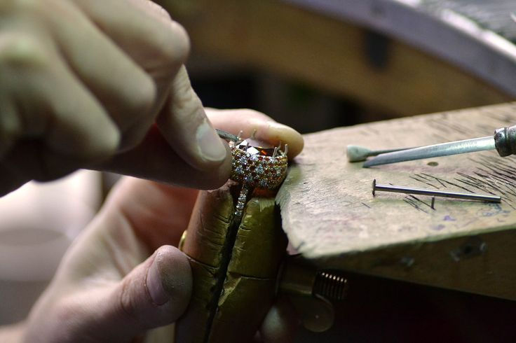 scenes from Margherita Burgener factory in Valenza, Italy.  Alberto is setting central stone on a custom made ring.