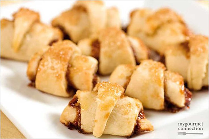 Raspberry Rugelach: These raspberry, walnut and cinnamon filled cookies are made from a rich, flaky cream cheese dough and lightly glazed with coarse sugar.