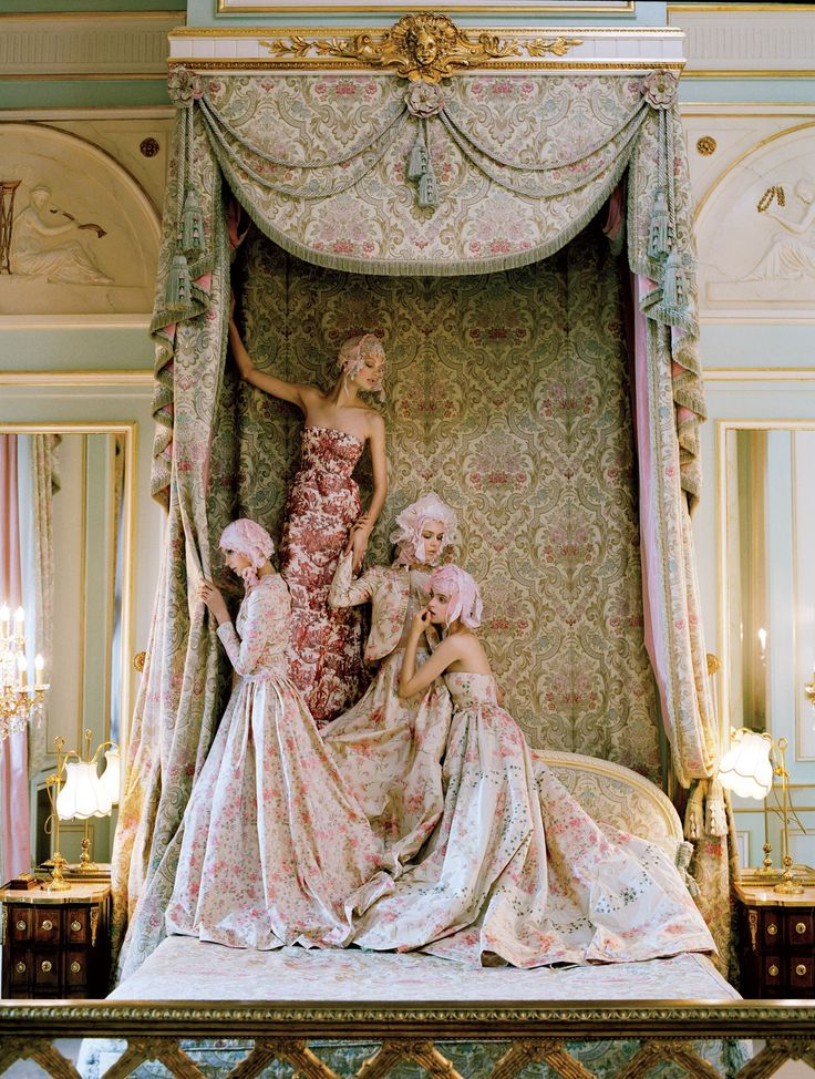 Snuggling into a royal-looking bed at the Ritz Paris are models Sigrid Agren, Patricia van der Vliet, Josephine Skriver, and Mirte Maas, all in Valentino Haute Couture.