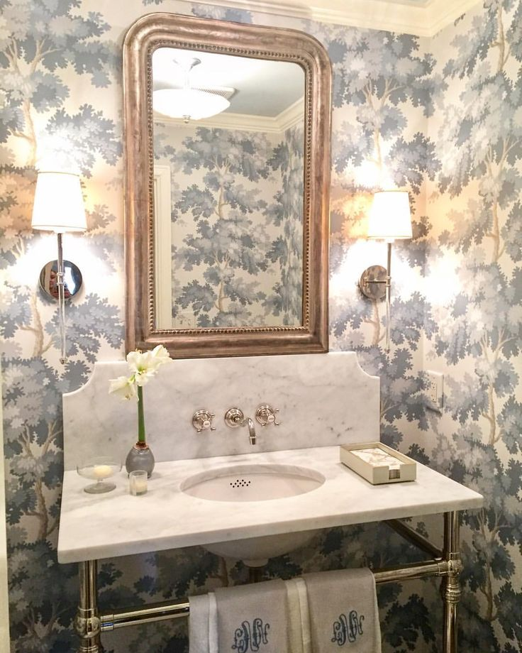 A recently completed jewel box of a powder room, w…