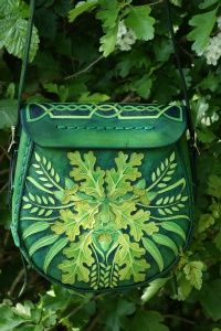 Elaborately detailed medium sized bag with Tree Of Life flap, knotwork and Green Man back by SkyRavenWolf