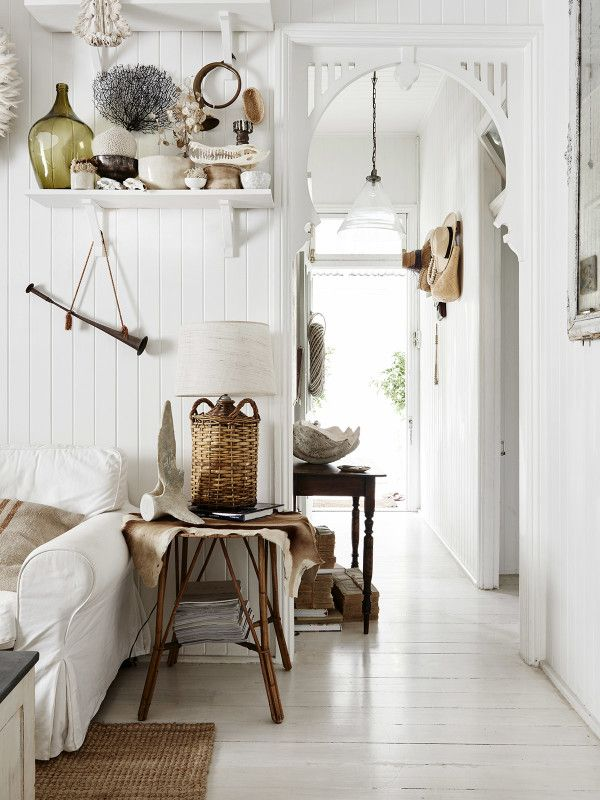 View from living room looking down hall towards front door. Photo – Eve Wilson. Production – Lucy Feagins / The Design Files.