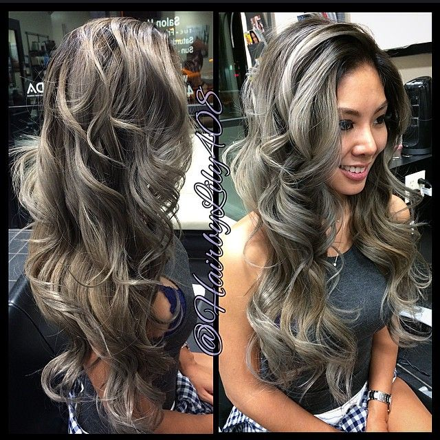 Stunning platinum highlights on dark brown hair.