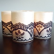 glue lace onto regular candle to make it pretty