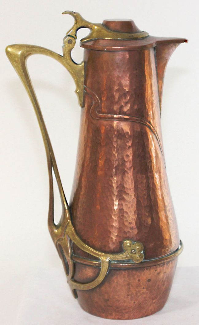 "WMF hammered copper flagon with applied cast brass Art Nouveau hardware, marked ""Ges Gesch. 24"" and stamped ostrich mark, 14-1/2"" H"