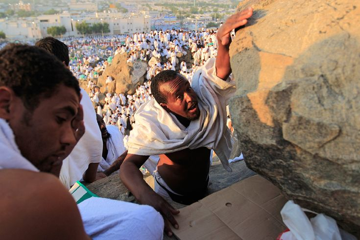 Muslim pilgrims climb a rocky hill called the Mountain of Mercy on the Plain of Arafat near Mecca, Saudi Arabia. #Hajj