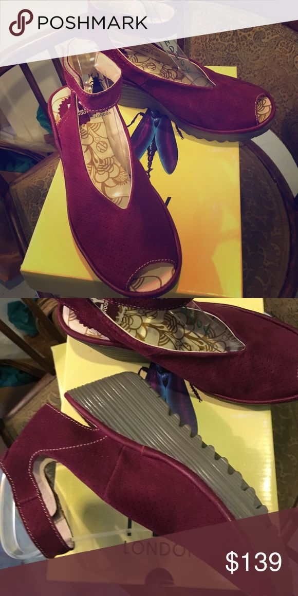 Fly London Ayala Fly London Burgundy Wedge Yala the most popular FL in their lexicon don't hesitate They brand new! They are adjustable at the ankle so feminine with that Peep toe You will love them! Fly London Shoes Wedges
