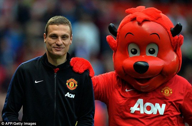 Fred the Red poses with former defender Nemanja Vidic in May 2014