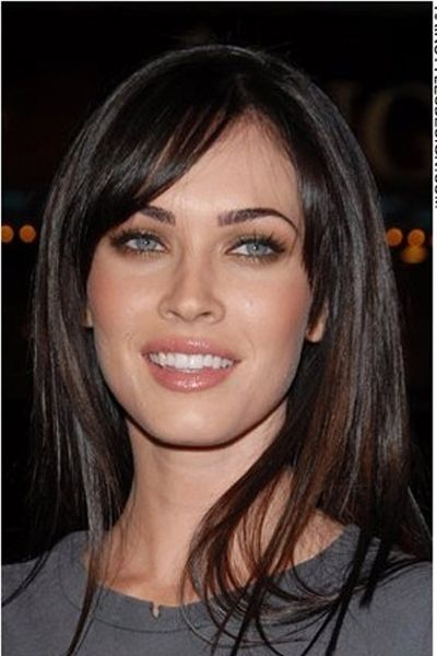 "This look is really cute as Megan Fox has her straight long hair styled around her face. Her hair falls evenly at the sides leaving bangs to be swept at the forehead.<span id=""desc_split""></span>This haircut is long.<span id=""desc_split""></span>The hair colouring is dark brown."