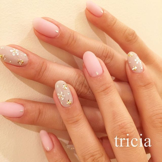 Pale Pink with Holo Accent nails and studs #nailart