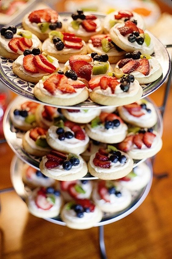 Mini fruit pizzas madye on sugar cookies - cute idea for a baby/bridal shower.