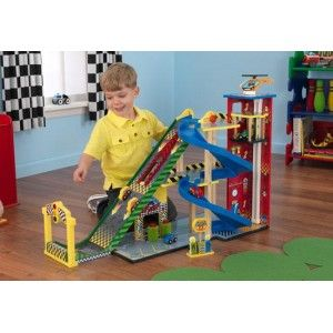 """KidKraft - Mega Ramp Racing Set: It's a speedy ramp, a parking garage, an elevator, a car wash and a gas station all in one convenient package! The centerpiece of this jumbo-sized racing set is its three-level """"Mega Ramp,""""  which launches cars high in the air after they build up momentum. There's even a launch pad that kids lower to let the cars go, guaranteeing that they take off at the same time. #alltotstreasures #kidkraft #megarampracingset #woodentoys #cars #racingcars #ramps"""