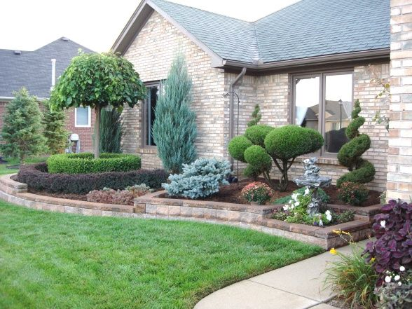 Front yard walls front yard retaining wall yard for Backyard landscape design ideas