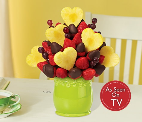 Love is in full bloom with this beautiful fruit arrangement! The Blooming Hearts™ fruit bouquet with Dipped Strawberries features our signature pineapple hearts and gourmet semisweet chocolate dipped strawberries, plus fresh strawberries and juicy grapes. #sweetestday #gift #ideas