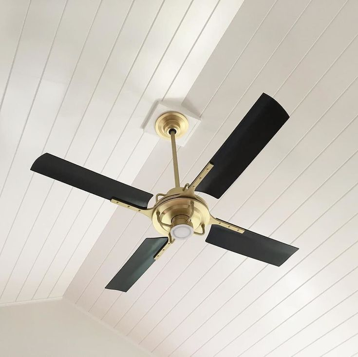 "Our Peregrine Industrial LED ceiling fan offers efficient and effective air movement throughout your room and beautifully fills the space in this vaulted ceiling. Custom downrods are available for our fans in a wide variety of sizes from 12""-72"" so that the fan you choose is just right for you. Photo by @hintdesign #myonepiece #ceilingfan #vaultedceiling #industrialfan"