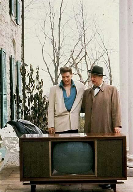 Elvis and the Colonel with console TV set on the front porch at Graceland in 1960. The TV was a gift from RCA for the sale for the sale of 50 million records!!!