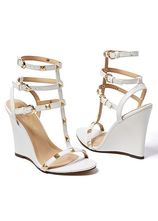 These wedges and skinny jeans make a great pair! Venus studded gladiator wedge.