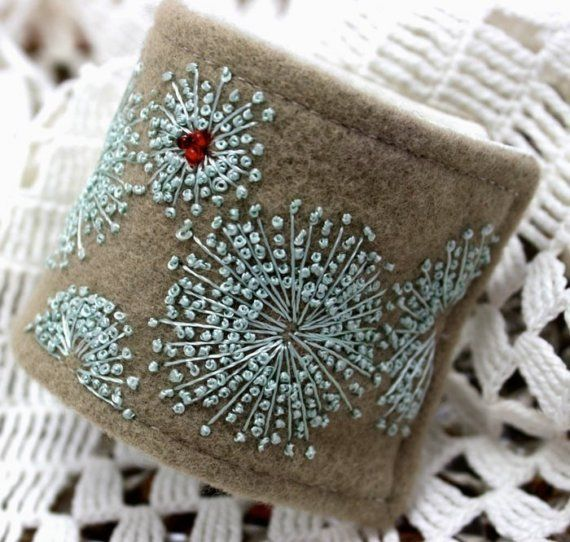 Beautiful cuff in felt with teal embroidered flowers and red beads by @Rose…