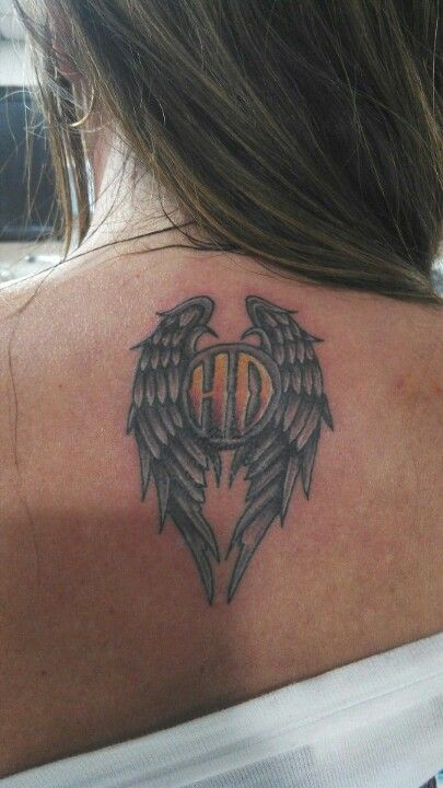 Harley Davidson's tattoo... I like this idea as a memorial tat to my dad