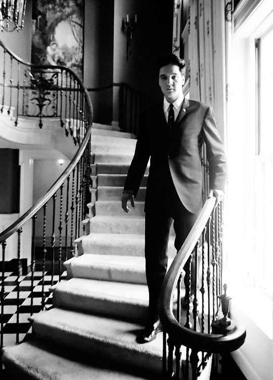 "Original Caption: ""Elvis Presley is checking out the governor's mansion after arriving with Ann Ellington, daughter of Gov. Buford Ellington, March 8, 1961. Photo by Gerald Holly / The Tennessean. """