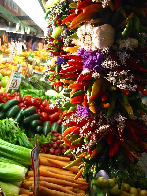 Chilis in the foreground, vegetables in the background at Pike Place Market, Seattle.