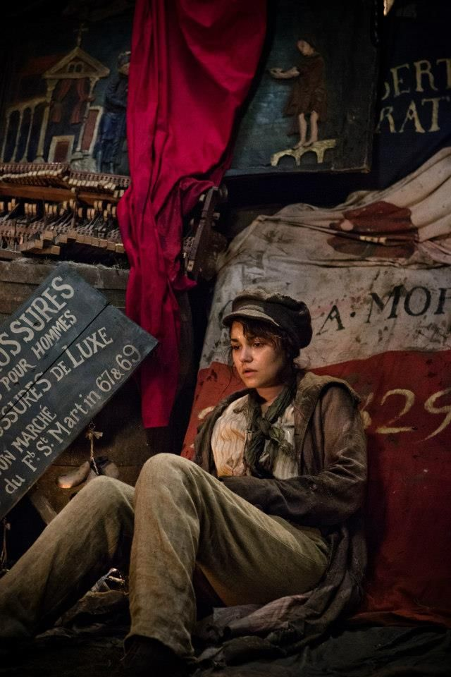 I feel like there is a lot in this photo. You can see her distress and the chaos around her. She's grieved, helpless, and alone. Eponine isn't my favorite character because she sings On My Own. She is my favorite because of the sacrifices she is willing to make. That even though her life and her childhood were so horrific, she still had the guts to give her love away and watch him be happy. I know some people may find her weak for loving someone so much but I think it was her greatest…