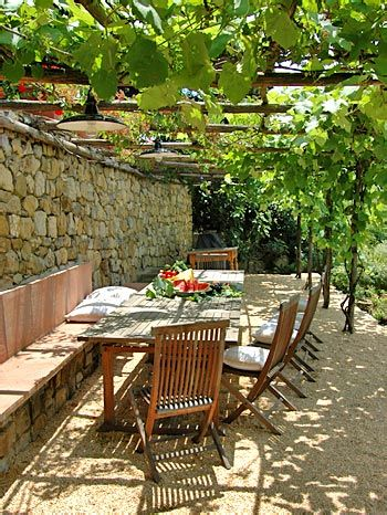 Casa Pepe, Tuscany, Italy I would love to grow grape vines on a pergola. So cool.