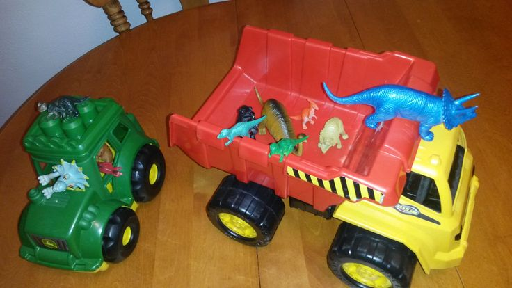November 11, 2014: The dinos have commandeered the dump truck and tractor for a joyride on the kitchen table.