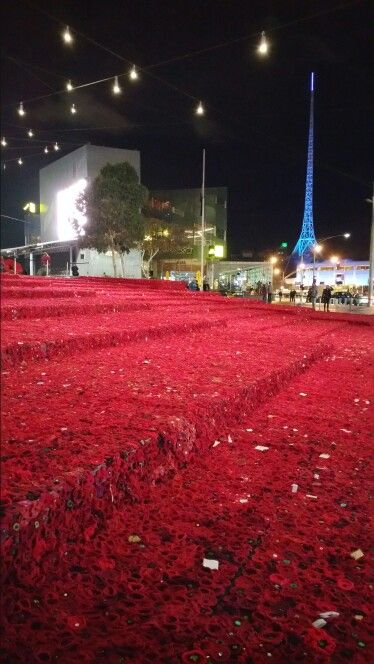 Carpet of crocheted poppies at Federation Square for Anzac Day