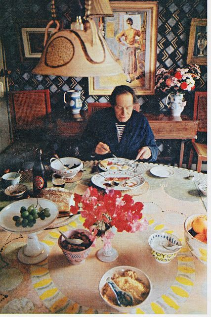 Duncan Grant in Charleston dining room 1964 eating from a dinner service designed by him for Clarice Cliff in 1934