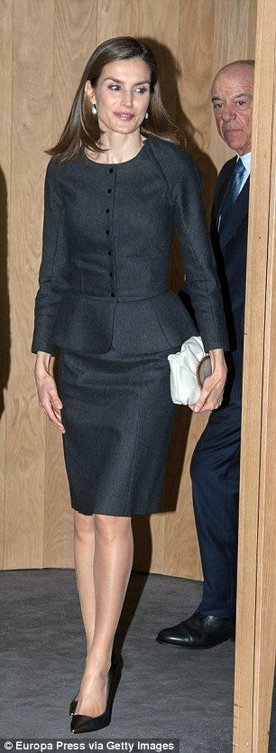 The mother-of-two wore a formal fitted two-piece suit in charcoal grey for her engagement in the Spanish capital