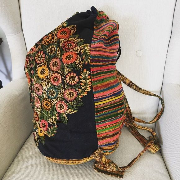 Extra Large Boho Backpack Extra Large Hippie Backpack · Very Big · Beautiful floral design on front · Stripes on back · Drawstring closure · Hand tied adjustable straps · ***some loose threads. · Measures 17x9.5x22 Bags Backpacks