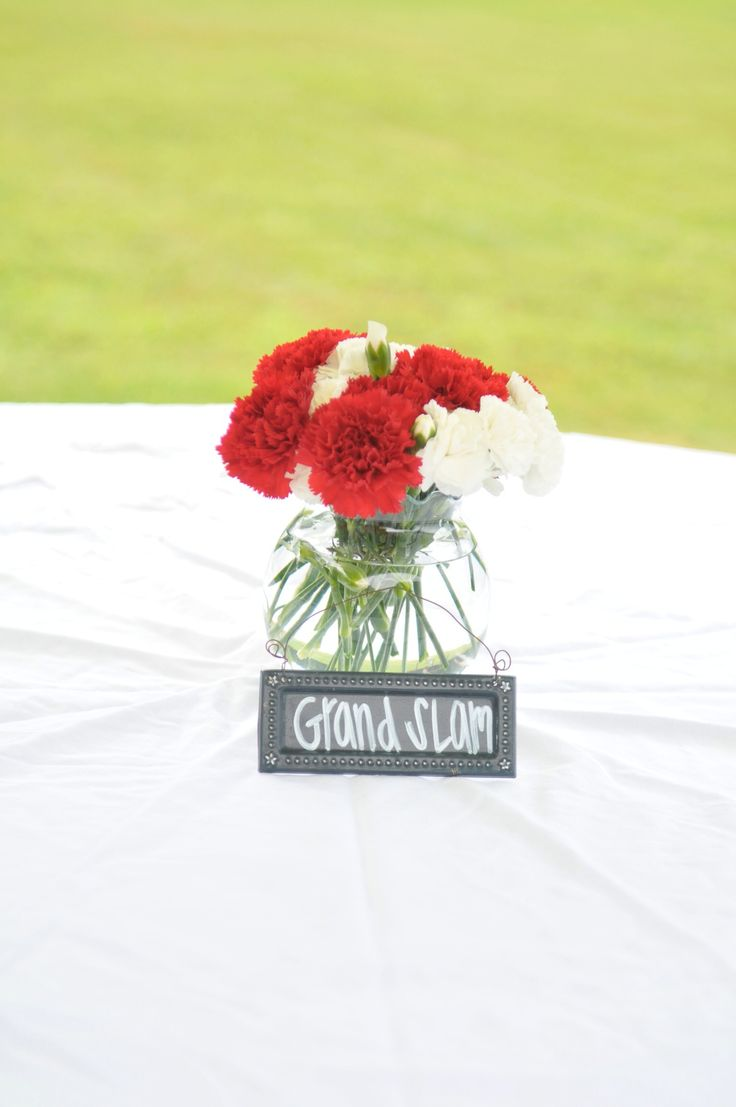 Baseball Theme Party. Red and white Carnations arranged into a baseball for table centerpieces.