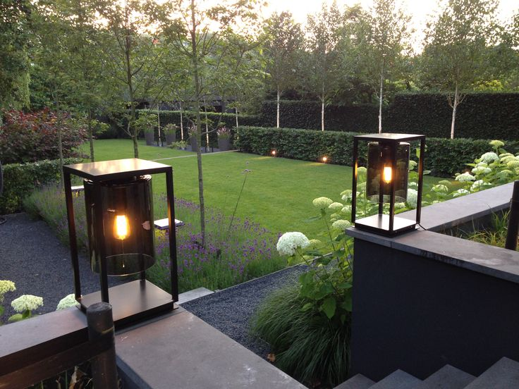 Illumination along stairs in chique black look with smoked black glass. At the back along the hedges we have used adjustable spots.