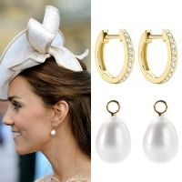 These earrings are a combination of two jewelers; Annoushka and Kiki McDonough.  The white Baroque pearl drops are  from Annoushka.  The diamond hoops originate from her Kiki McDonough green amethyst oval drop earrings.  The diamond set hoops are created from 18ct yellow gold.