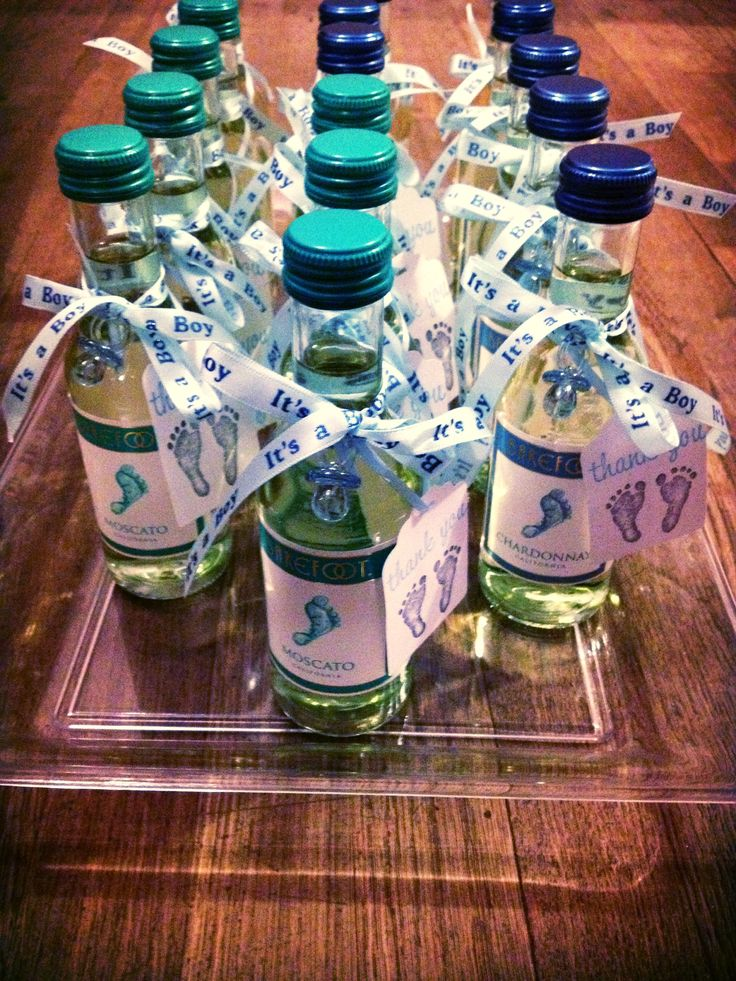 DIY Baby Shower Favors. I finally finished them. The final product is both BAREFOOT WINE Moscato and Chardonnay mini bottles with ribbon, mini blue pacifiers and handmade tags from Etsy.