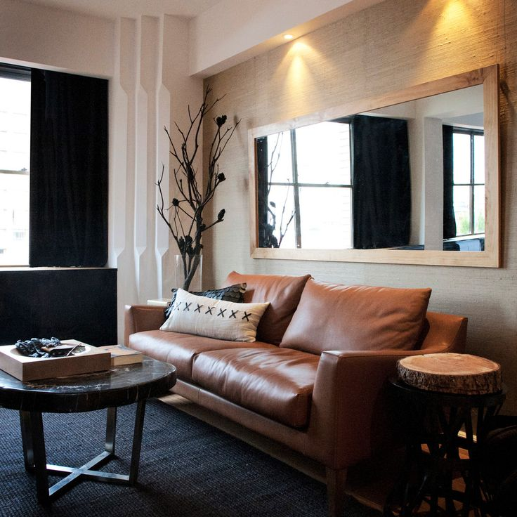 Beautiful Brown Leather Sofa convention Sydney Contemporary Living Room Image Ideas with accent lighting beige throw pillow black coffee table black curtain black rug branches brown